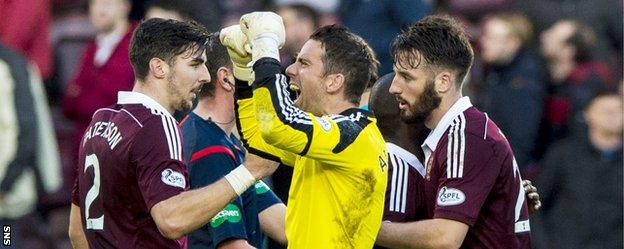 Former Rangers goalkeeper Neil Alexander celebrates Hearts' 2-0 win