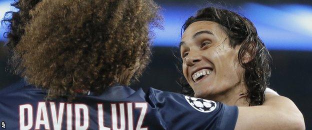Paris St-Germain's Edinson Cavani celebrates scoring against Ajax