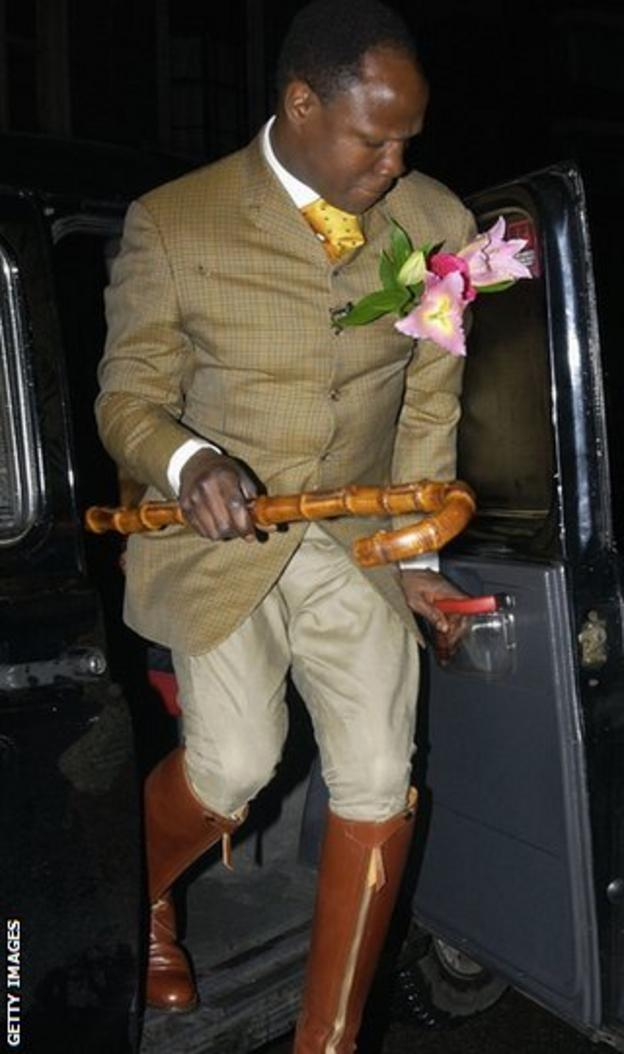 Chris Eubank Sr in riding boots with cane
