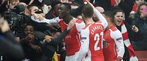 Yaya Sanogo (left) celebrates