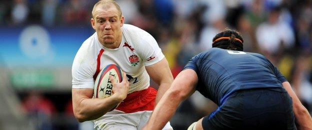 Mike Tindall takes on France's Jerome Thion