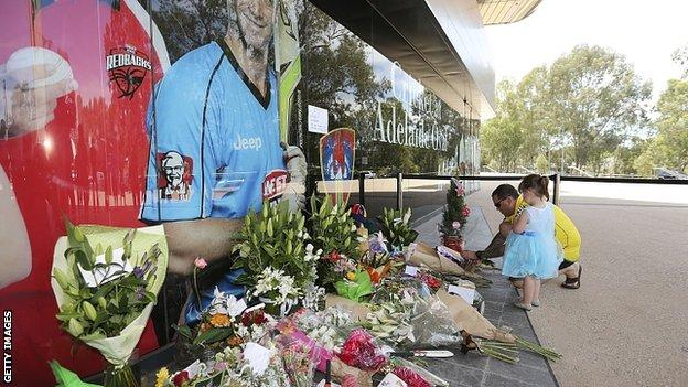 Flowers laid next to photograph of Phillip Hughes outside Adelaide Oval. 28 Nov 2014