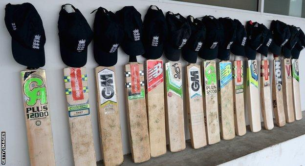 England bats in a row outside their dressing room