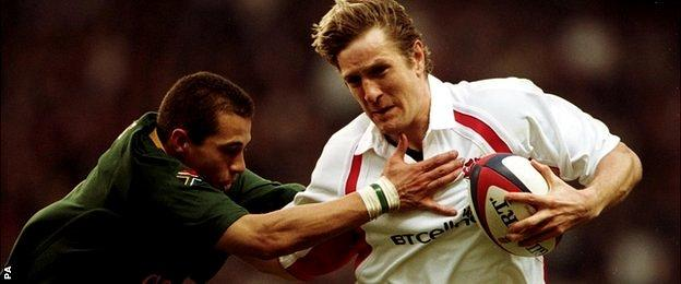 England's Will Greenwood takes on South Africa's Conrad Jantjes