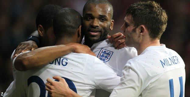 England's Darren Bent (centre) celebrates with team mates Glen Johnson (left), Ashley Young (2nd left) and James Milner