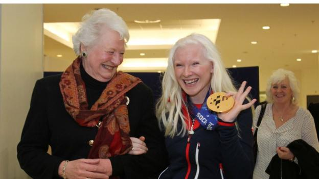 Dame Mary Peters was among those who welcomed Kelly Gallagher home to Belfast after she won Paralympics GB's first ever gold medal at the Winter Games in Sochi in the visually impaired Super-G class
