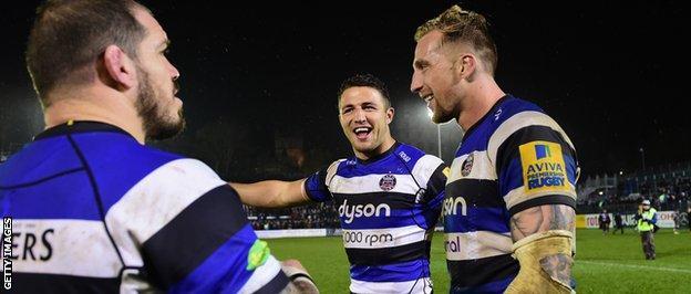 Burgess celebrates with his Bath team-mates