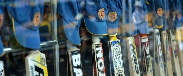 Sri Lankan bats and caps are lined up in tribute to young Australian batsman Phillip Hughes who died