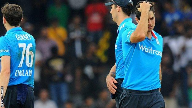 England captain Alastair Cook (right)