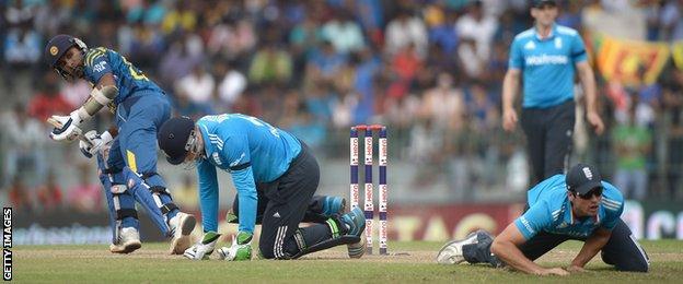 Sri Lanka's Mahela Jayawardene hits the ball past England's Alastair Cook