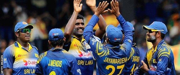 Sri Lanka celebrate a wicket by Thisara Perera (centre)