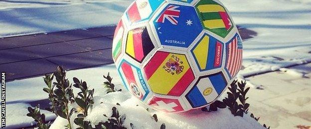 Tim Cahill puts out a soccer ball in memory of Phillip Hughes