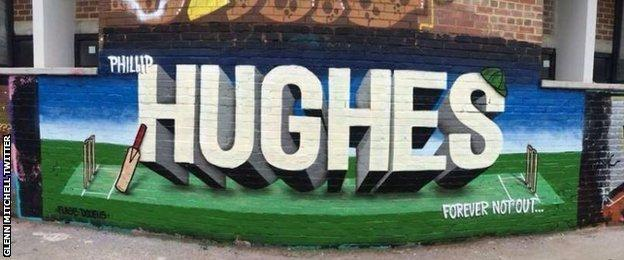 A special piece of graffiti is displayed on wall in Perth in homage to Phillip Hughes