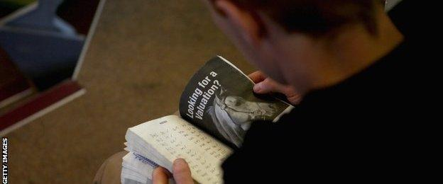 Studying the pedigrees at the Tattersalls sale