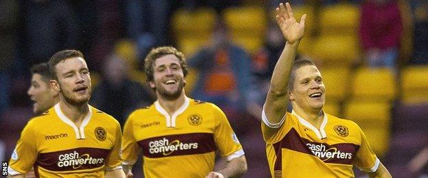 Henrik Ojamaa waves to the home fans after scoring for Motherwell