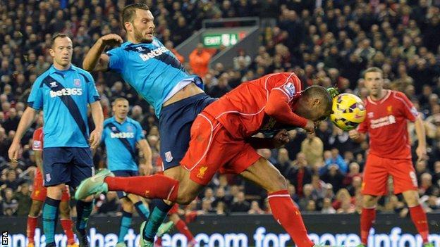 Liverpool defender Glen Johnson (centre) stoops to head in his side's winner against Stoke
