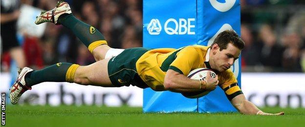 Bernard Foley dives over to score for Australia