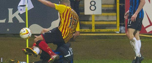 Jake Carroll is up-ended by Hamilton's Dougie Imrie, who was sent off for the challenge