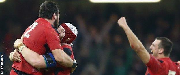 Scott Baldwin and Jake Ball celebrate Wales' win, as does Sam Warburton
