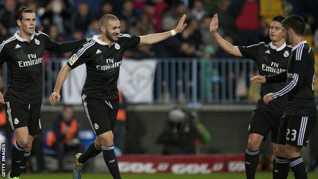 Real Madrid striker Karim Benzema celebrates his goal against Malaga