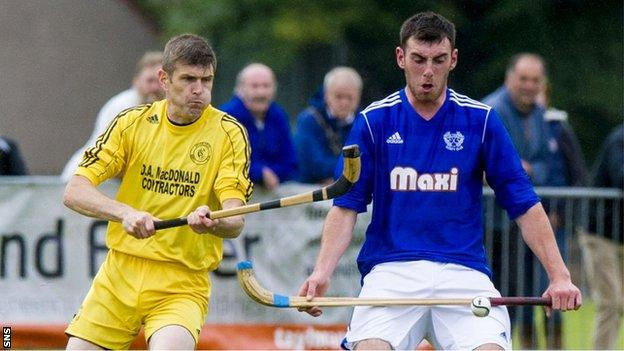 Zac Coley (right) holds off Inveraray's Ruaraidh Graham in the Celtic Society Cup final in June