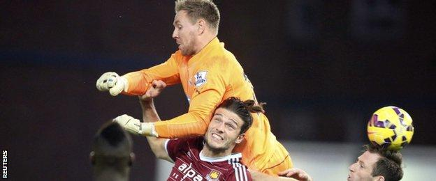Newcastle's Rob Elliot and West Ham's Andy Carroll