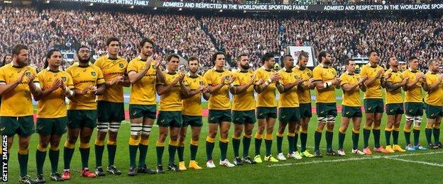 Australia's rugby team observe a minute's applause at Twickenham