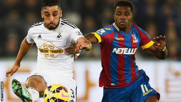 Neil Taylor in action against Crystal Palace.