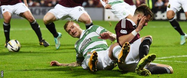 Brad McKay (right) pleads innocence after John Guidetti hits the deck to win a penalty.