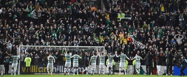 Celtic manager Ronny Deila leads his team over to celebrate at full-time in front of the travelling support.