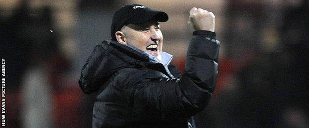 Russell Slade celebrates Cardiff City's win at Watford