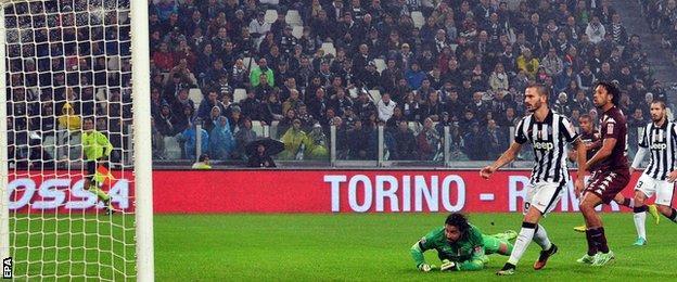 Goalkeeper Marco Storari is beaten as Torino equalise