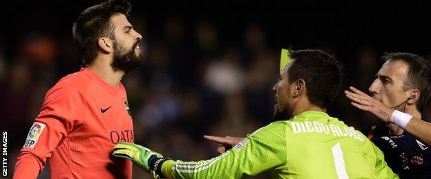 Barcelona defender Gerard Pique was booked following a first-half flare-up