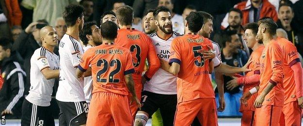 Barcelona and Valencia players clash