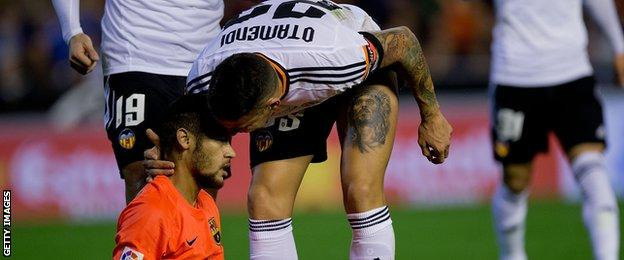 Nicolas Otamendi of Valencia and Barcelona's Neymar