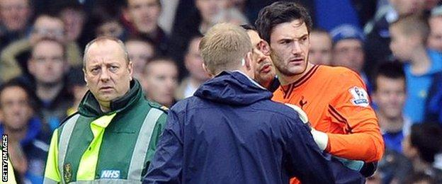 Hugo Lloris receives treatment after a head injury