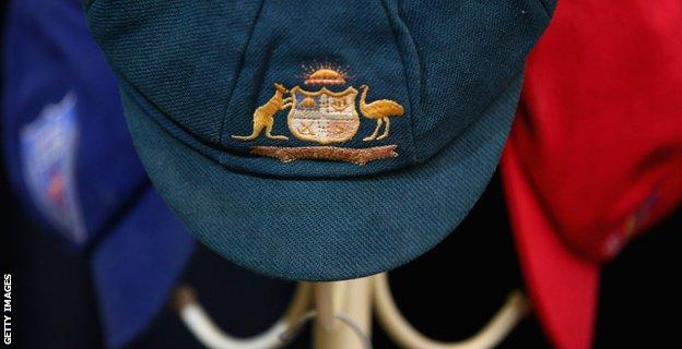 The Baggy Green of Phillip Hughes and his state cricket caps hang on a hat rack at Macksville High School