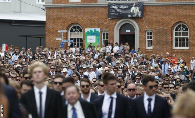 Thousands march through Macksville following the funeral