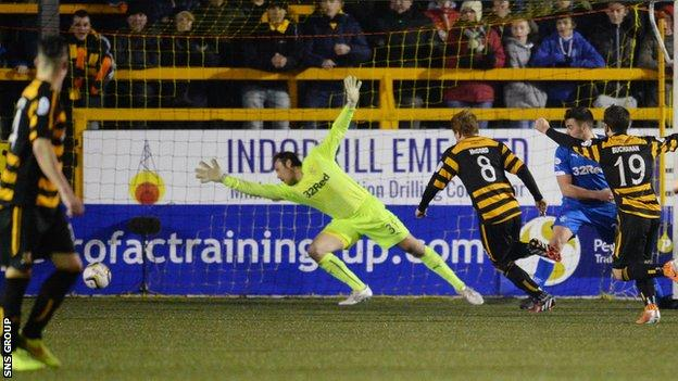 Alloa's Ryan McCord (8) side foots into the back of the net to equalise for his side