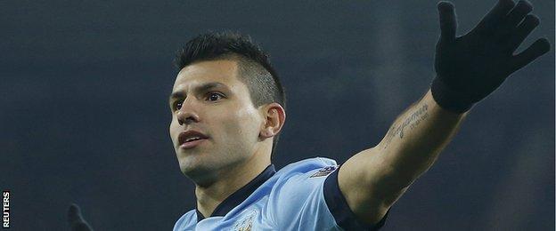 Sergio Aguero celebrates scoring his second goal against Sunderland