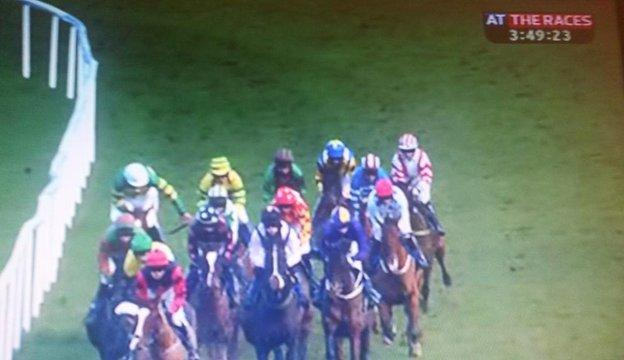 Davy Russell takes the whip from Philip Enright