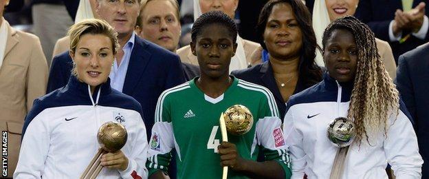 Asisat Oshoala collects the Golden Ball trophy at the U20 Women's World Cup