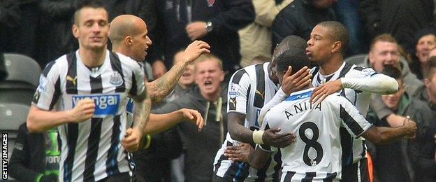 Newcastle players celebrate a goal against Chelsea