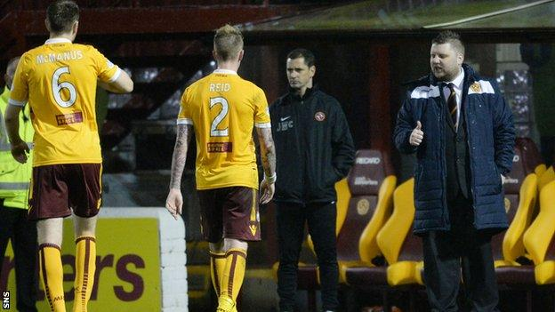 Motherwell general manager Alan Burrows (far right) congratulates the team after victory over Dundee United.