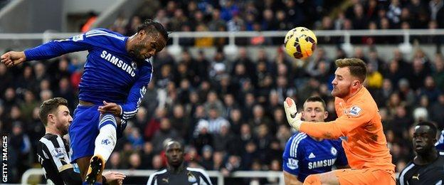 Chelsea striker Didier Drogba scores a header in his side's 2-1 defeat at Newcastle