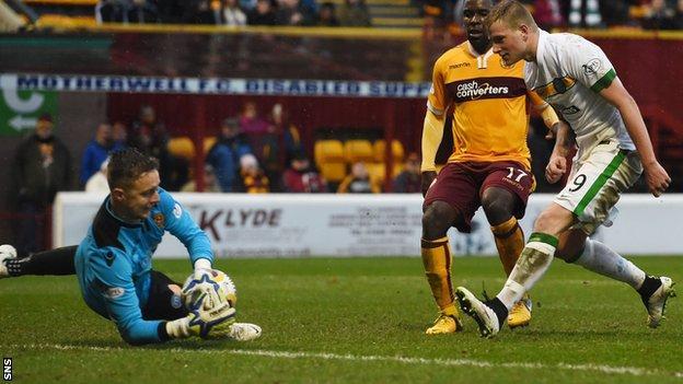Motherwell goalkeeper Dan Twardzik makes a save following John Guidetti's shot