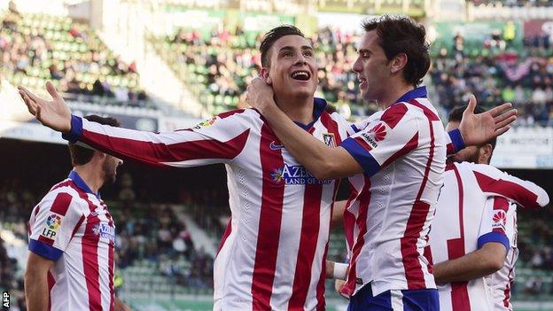 Atletico Madrid's Jose Maria Gimenez (left) celebrates scoring the opening goal