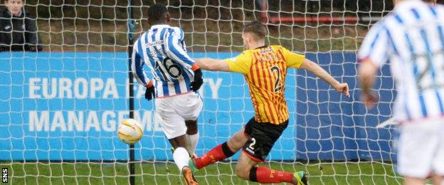 Tope Obadeyi pokes home the opener for Kilmarnock