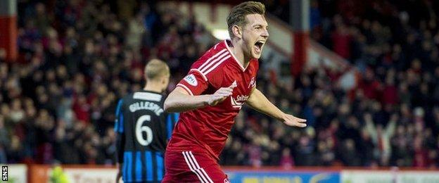 Ash Taylor celebrates after scoring for Aberdeen against Hamilton