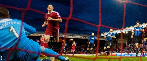 Adam Rooney celebrates after scoring a penalty against Hamilton